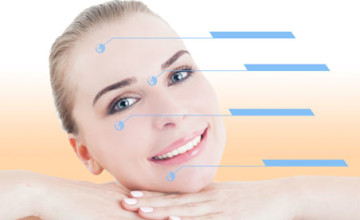 Young smiling beautiful female with perfect skin and facial treatment indicators on her face